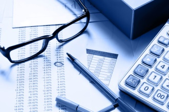 Financial statements glasses and calculator
